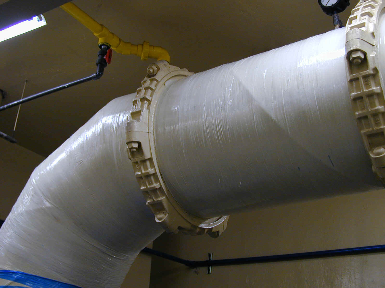 Large Tube Elbow wrapped with Powersleeve to Reinforce Corrosion Damaged Pipe